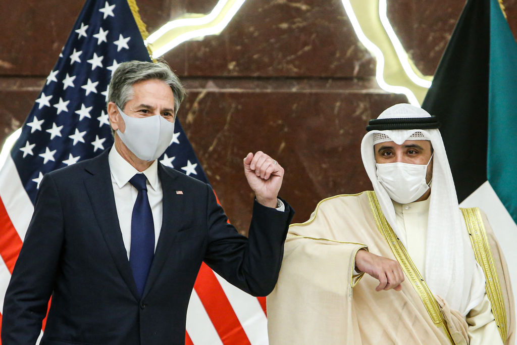 (L to R) US Secretary of State Antony Blinken and Kuwaiti Foreign Minister Sheikh Ahmad Nasser al-Mohammed Al-Sabah elbow bump each other during a press conference at Kuwait's foreign ministry headquarters in Kuwait City on July 29, 2021. (Photo by Yasser Al-Zayyat / AFP) (Photo by YASSER AL-ZAYYAT/AFP via Getty Images)