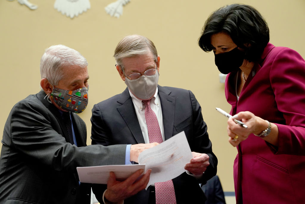 """WASHINGTON, DC - APRIL 15: Dr. Anthony Fauci, Director of NIAID and Chief Medical Advisor to the President, Dr. David Kessler, Chief Science Officer of the White House COVID Response Team, and CDC Director Rochelle Walensky confer before a House Select Subcommittee on the Coronavirus Crisis hearing on April 15, 2021 on Capitol Hill in Washington, DC. The committee is hearing testimony on """"The role of the National Institute of Allergy and Infectious Diseases in Research Addressing COVID-19."""" (Photo by Amr Alfiky-Pool/Getty Images)"""