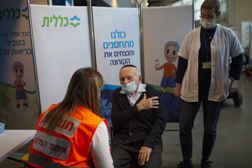 FILE - In this Jan. 21, 2021 file photo, Holocaust survivor Joseph Zalman Kleinman gestures to the arm he prefers to receive the second dose of the Pfizer vaccine for COVID-19, in Jerusalem. Kleinman who lived through through the Auschwitz death camp and testified against Adolf Eichmann in the Nazi commander's trial in Jerusalem, died Tuesday in Israel. He was 91. (AP Photo/Maya Alleruzzo, File)