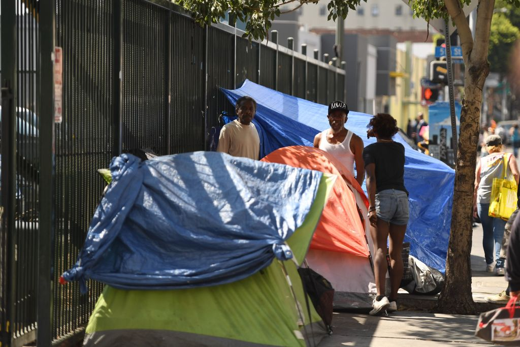 Tents line the street in Skid Row in Los Angeles, California on September 17, 2019. - US President Donald Trump has indicated he plans to address the homeless crisis in California as he lands later today in Los Angeles for a two-day visit with stops for fundraising in Palo Alto, Beverly Hills and San Diego. (Photo by Robyn Beck / AFP) (Photo credit should read ROBYN BECK/AFP via Getty Images)