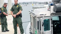 SAN DIEGO, CA - JUNE 22: Border Patrol agents stand next to a Secure Around Safety Floatation (SAFE)Boat during the unveiling of a new U.S. Border Patrol Marine Unit on June 22, 2021 in San Diego, California. The new unit will help detect, deter and interdict human smuggling incursions along the coast of California.(Photo by Sandy Huffaker/Getty Images)