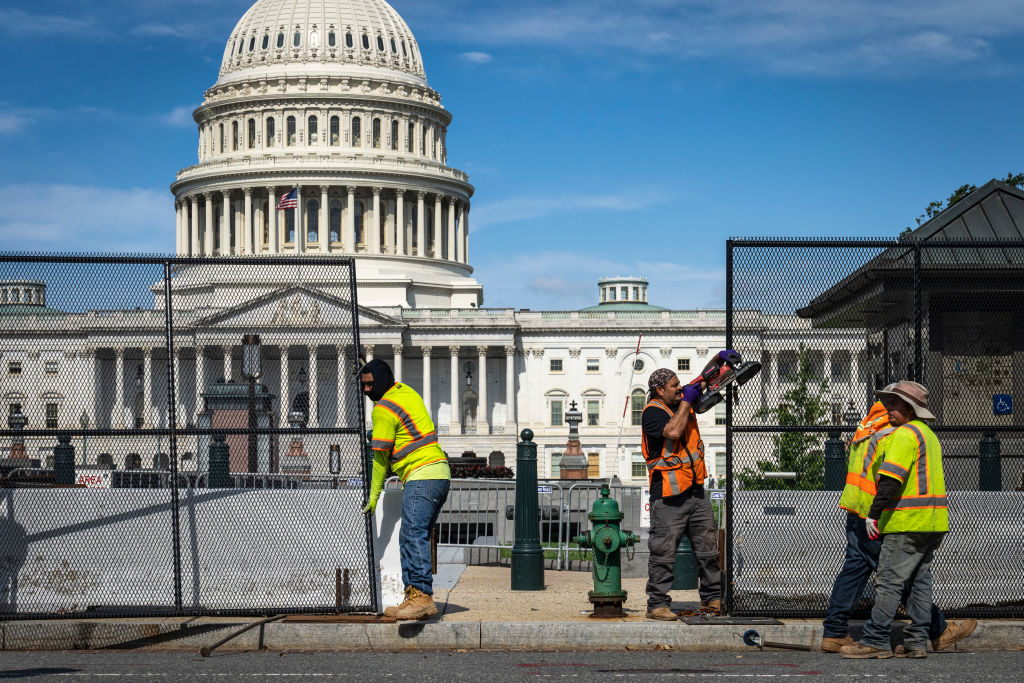 WASHINGTON, DC - JULY 10: Workers remove security fencing surrounding the U.S. Capitol on July 10, 2021 in Washington, DC. The security fence was erected in the wake of the January 6 attack on the Capitol and will be mostly removed this weekend. (Photo by Drew Angerer/Getty Images)