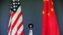 The US and China flags stand behind a microphone awaiting the arrival of US Senator John McCain, who was joined by Senators Lindsey Graham Amy Klobuchar for a press conference at the US Embassy in Beijing on April 9, 2009 during the China stop of the Congressional Delegation's fact-finding Asia-tour. Senator McCain said he urged Chinese officials in talks here to back a strong United Nations response to North Korea's rocket launch, but indicated China had resisted. AFP PHOTO/Frederic J. BROWN (Photo credit should read FREDERIC J. BROWN/AFP via Getty Images)