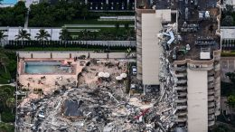 TOPSHOT - This aerial view, shows search and rescue personnel working on site after the partial collapse of the Champlain Towers South in Surfside, north of Miami Beach, on June 24, 2021. - The multi-story apartment block in Florida partially collapsed early June 24, sparking a major emergency response. Surfside Mayor Charles Burkett told NBCs Today show: My police chief has told me that we transported two people to the hospital this morning at least and one has died. We treated ten people on the site. (Photo by CHANDAN KHANNA / AFP) (Photo by CHANDAN KHANNA/AFP via Getty Images)