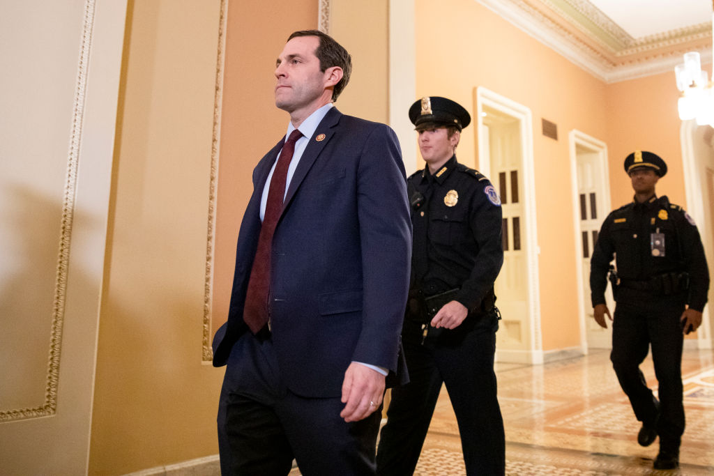 """WASHINGTON, DC - JANUARY 27: Representative Jason Crow (D-CO), one of the Democratic impeachment managers from the House of Representatives, heads back to the Senate floor during the Senate impeachment trial of President Donald Trump on January 27, 2020 in Washington, DC. The defense team continues its arguments on the sixth day of the Senate impeachment trial of President Trump. It has been reported that Senator Pat Toomey has been discussing that a """"one-for-one"""" witness deal be proposed to Senate Democrats after the Presidents legal defense team concludes their opening arguments on Tuesday. (Photo by Samuel Corum/Getty Images)"""