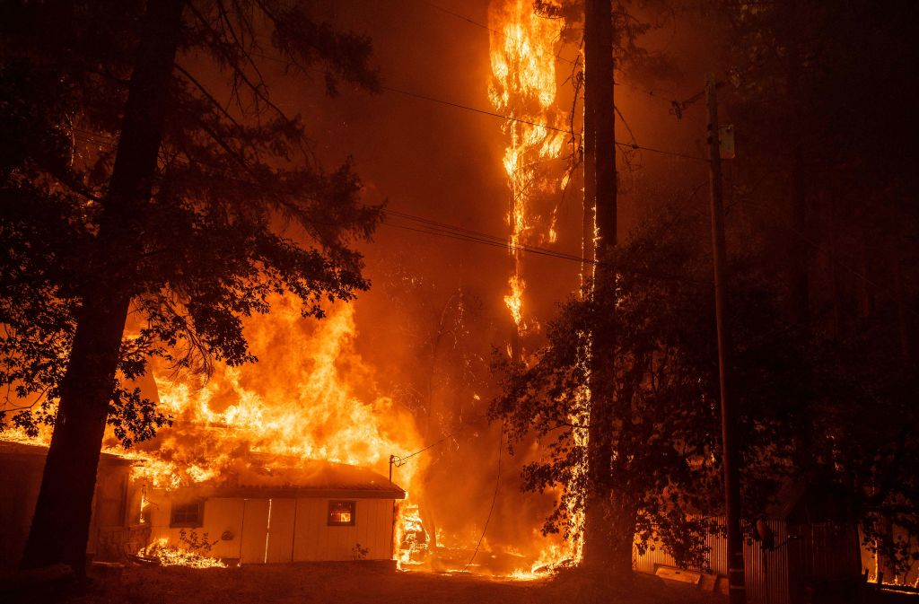 A home burns as flames from the Dixie fire tear through the Indian Falls neighborhood of unincorporated Plumas County, California on July 24, 2021. - The Dixie fire, which started only a few miles from the origin of the deadly Camp fire, has churned through more than 185,000 acres and continues to burn towards rural communities. (Photo by JOSH EDELSON / AFP) (Photo by JOSH EDELSON/AFP via Getty Images)