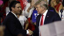 Gov. Ron DeSantis, left, shakes hand with President Trump, right, at the Florida Fairgrounds. (AP Photo)