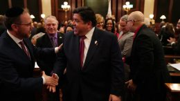SPRINGFIELD, IL - FEBRUARY 20: Illinois Gov. J.B. Pritzker is congratulated by lawmakers after delivering his first budget address to a joint session of the llinois House and Senate at the Illinois State Capitol on February 20, 2019 in Springfield, Illinois. (Photo by E. Jason Wambsgans/Pool/Getty Images)