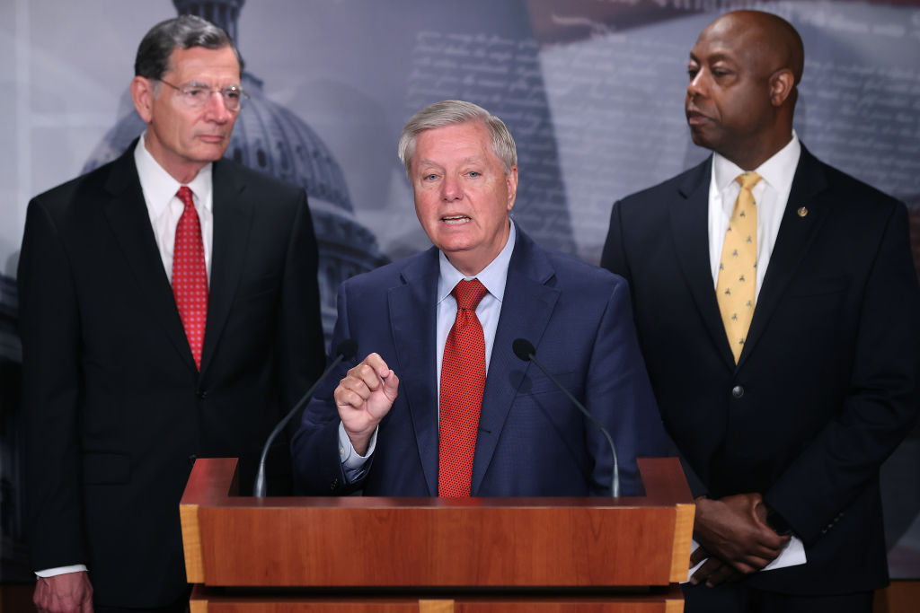 WASHINGTON, DC - JULY 21: Sen. Lindsey Graham (R-SC) (C) joins Sen. John Barrasso (R-WY) (L), Sen. Tim Scott (R-SC) and other Senate Republicans during a news conference at the U.S. Captiol on July 21, 2021 in Washington, DC. Graham organized the news conference to criticize what he called the Senate Democrats' 'spending spree.' (Photo by Chip Somodevilla/Getty Images)