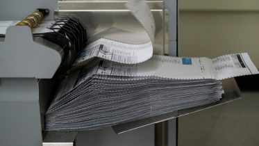 RENTON, WA - AUGUST 04: Ballots are seen in a machine after the scanning process at the King County Elections headquarters on August 4, 2020 in Renton, Washington. Today is election day for the primary in Washington state, where voting is done almost exclusively by mail. (Photo by David Ryder/Getty Images)