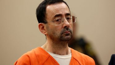 Former Michigan State University and USA Gymnastics doctor Larry Nassar appears at Ingham County Circuit Court on November 22, 2017 in Lansing, Michigan. Former USA Gymnastics team doctor Lawrence (Larry) Nassar, accused of molesting dozens of female athletes over several decades, on Wednesday pleaded guilty to multiple counts of criminal sexual conduct. Nassar -- who was involved with USA Gymnastics for nearly three decades and worked with the country's gymnasts at four separate Olympic Games -- could face at least 25 years in prison on the charges brought in Michigan. / AFP PHOTO / JEFF KOWALSKY (Photo credit should read JEFF KOWALSKY/AFP via Getty Images)