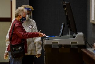 FAYETTEVILLE, NC - NOVEMBER 03: Dorothy Higginbotham, 90 years old, places her ballot into a tabulating machine on Election Day at Church of Jesus Christ of latter-day Saints on November 3, 2020 in Fayetteville, North Carolina. After a record-breaking early voting turnout, Americans head to the polls on the last day to cast their vote for incumbent U.S. President Donald Trump or Democratic nominee Joe Biden in the 2020 presidential election. (Photo by Melissa Sue Gerrits/Getty Images)