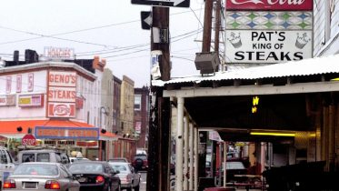 ** FILE ** In this May 24, 2000 file photo Pat's King of Steaks, right, and Geno's Steaks, which are both known for their Philadelphia cheesesteaks, are shown in Philadelphia. (AP Photo/Dan Loh, File)