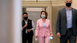 WASHINGTON, DC - JULY 25: House Speaker Nancy Pelosi (D-CA) (C) wears a protective mask while departing the U.S. Capitol on July 25, 2021 in Washington, DC. Pelosi stated in an interview on Sunday that she planned to appoint Representative Adam Kinzinger (R-IL) to the House select committee to investigate January 6. (Photo by Stefani Reynolds/Getty Images)