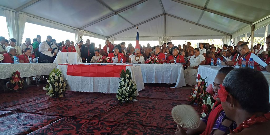 Fiame Naomi Mata'afa (seated C-in white) sits with members of parliament and the judiciary as she is sworn in as Samoa's first woman prime minister in Apia on May 24, 2021, at an extraordinary makeshift tent ceremony after the island nation's long-ruling government refused to cede power and locked the doors of parliament. (Photo by Malietau Malietoa / AFP) (Photo by MALIETAU MALIETOA/AFP via Getty Images)