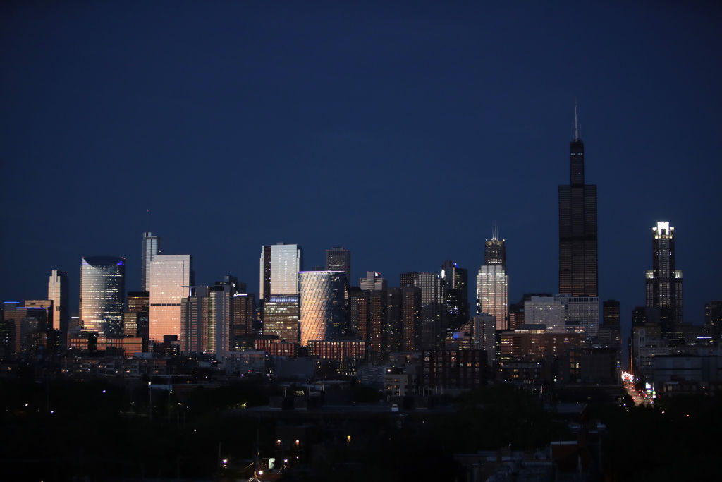 CHICAGO, ILLINOIS - MAY 20: The Willis Tower rises above the downtown skyline as a blackened mass after flooding caused by recent heavy rains knocked out power to the building Monday on May 20, 2020 in Chicago, Illinois. The Willis Tower, constructed as the Sears Tower, was once the world's tallest building. (Photo by Scott Olson/Getty Images)