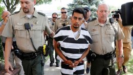 Cristhian Bahena Rivera is escorted into the Poweshiek County Courthouse for his initial court appearance, Wednesday, Aug. 22, 2018, in Montezuma, Iowa. Rivera is charged with first-degree murder in the death of Mollie Tibbetts, who disappeared July 18 from Brooklyn, Iowa. (AP Photo/Charlie Neibergall)