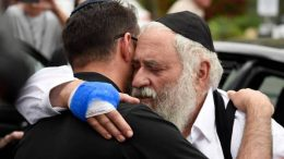 Rabbi Yisroel Goldstein, right, is hugged as he leaves a news conference at the Chabad of Poway synagogue, Sunday, April 28, 2019, in Poway, Calif. A man opened fire Saturday inside the synagogue near San Diego as worshippers celebrated the last day of a major Jewish holiday. (AP Photo/Denis Poroy)