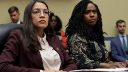 WASHINGTON, DC - JULY 26: House Oversight and Government Reform Committee members Rep. Alexandria Ocasio-Cortez (D-NY) (L) and Rep. Ayanna Pressley (D-MA) attend a hearing on drug pricing in the Rayburn House Office building on Capitol Hill July 26, 2019 in Washington, DC. As members of a group of four freshman Democratic women of color, known informally as 'The Squad,' the congresswomen heard testimony from patients and their family members about the negative impacts of rising drug prices in the United States. (Photo by Chip Somodevilla/Getty Images)