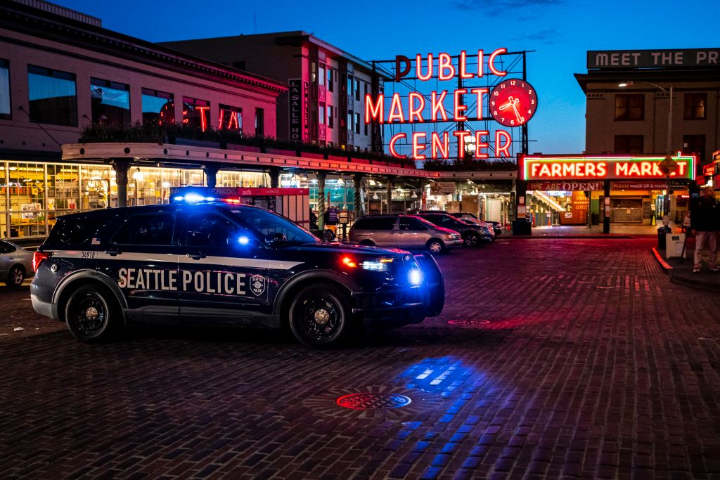 SEATTLE, WA - APRIL 12: A police vehicle follows behind a group of demonstrators near Pike Place Market as they protest the death of Daunte Wright on April 12, 2021 in Seattle, Washington. Police say the device serves as a non-lethal means of dispersing crowds and can be used to communicate with protesters, but critics say it can be used as a weapon. Wright, a Black man whose car was stopped in Brooklyn Center, Minnesota on Sunday reportedly for an expired registration, and not far from where George Floyd was killed during an arrest in Minneapolis last May, was shot and killed by an officer who police say mistook her service revolver for a Taser. (Photo by David Ryder/Getty Images)