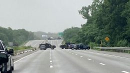 This photo provided by Massachusetts State Police shows police blocking off a section of Interstate 95 near Wakefield, Mass., on Saturday, July 3, 2021. Police say a group of heavily-armed men refuse to comply with law enforcement officers following a traffic stop. Police say the men headed into a wooded area and two suspects were arrested a short time later. Officials were still trying to capture the others in the group ( Massachusetts State Police via AP)