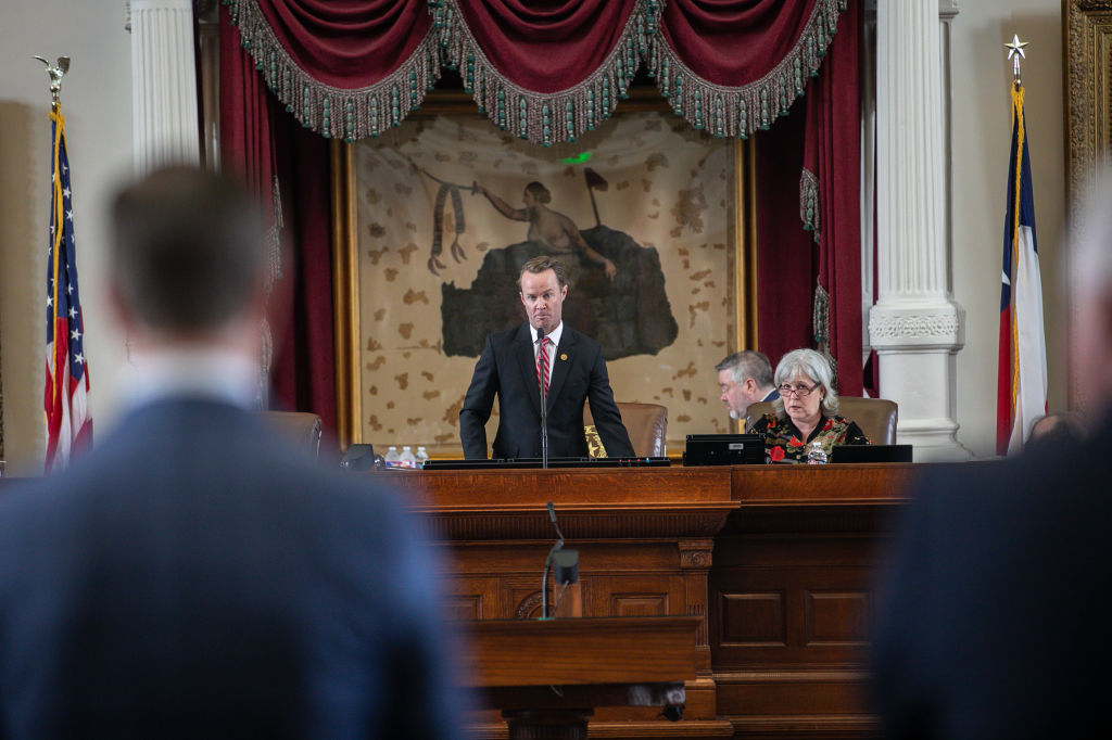AUSTIN, TX - JULY 13: Speaker of the Texas House U.S. Rep. Dade Phelan (R-TX) (C) listens to U.S. Rep. Will Metcalf (R-TX) (L) move to issue a call of the House to try to regain a quorum on July 13, 2021 in Austin, Texas. The Texas House voted to arrest Democrats who fled the state to deny a quorum in protest of Republicans' controversial voting bill. (Photo by Montinique Monroe/Getty Images)