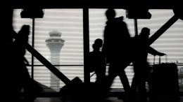 Travelers walk through terminal 3 at O'Hare International Airport in Chicago, Wednesday, Nov. 23, 2016. While driving remains the most popular form of transportation Thanksgiving travelers take, AAA expects just under 4 million people to fly to their holiday destinations. (AP Photo/Nam Y. Huh)