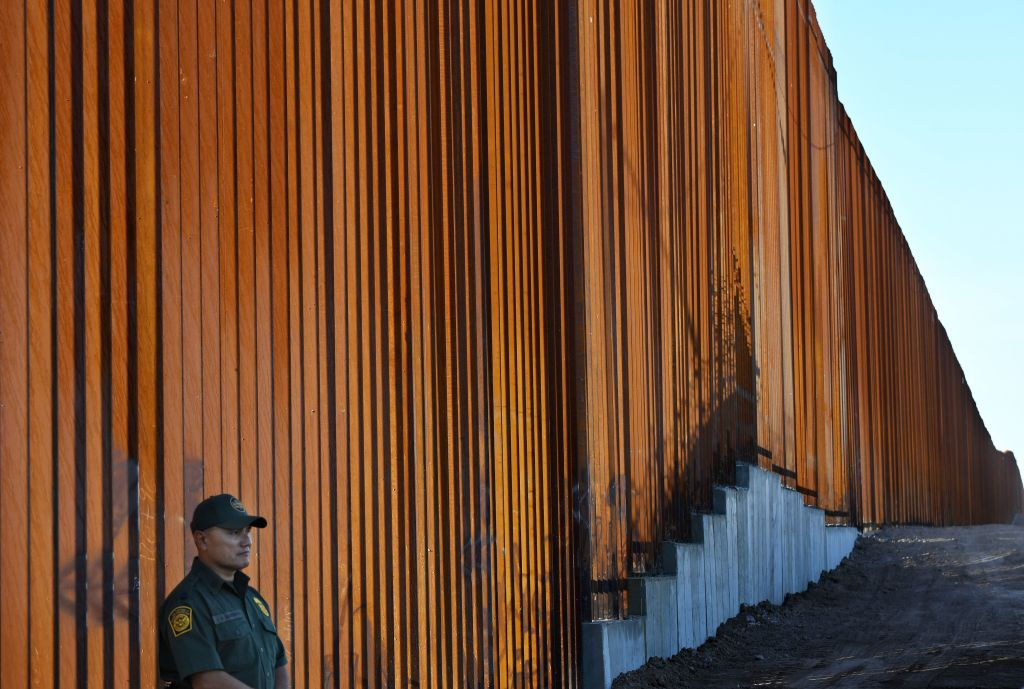 TOPSHOT - Border Patrol officers keep warch before U.S. Department of Homeland Security Secretary Kirstjen M. Nielsen inaugurates the first completed section of President Trumps 30-foot border wall in the El Centro Sector, at the US Mexico border in Calexico, California on October 26, 2018. (Photo by Mark RALSTON / AFP) (Photo credit should read MARK RALSTON/AFP via Getty Images)