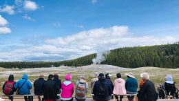 Tourists wait for the eruption of Old Faithful geyser in Yellowstone National Park in Wyoming on June 11, 2019. - Old Faithful has erupted every 44 to 125 minutes since 2000. (Photo by Daniel SLIM / AFP) (Photo credit should read DANIEL SLIM/AFP via Getty Images)