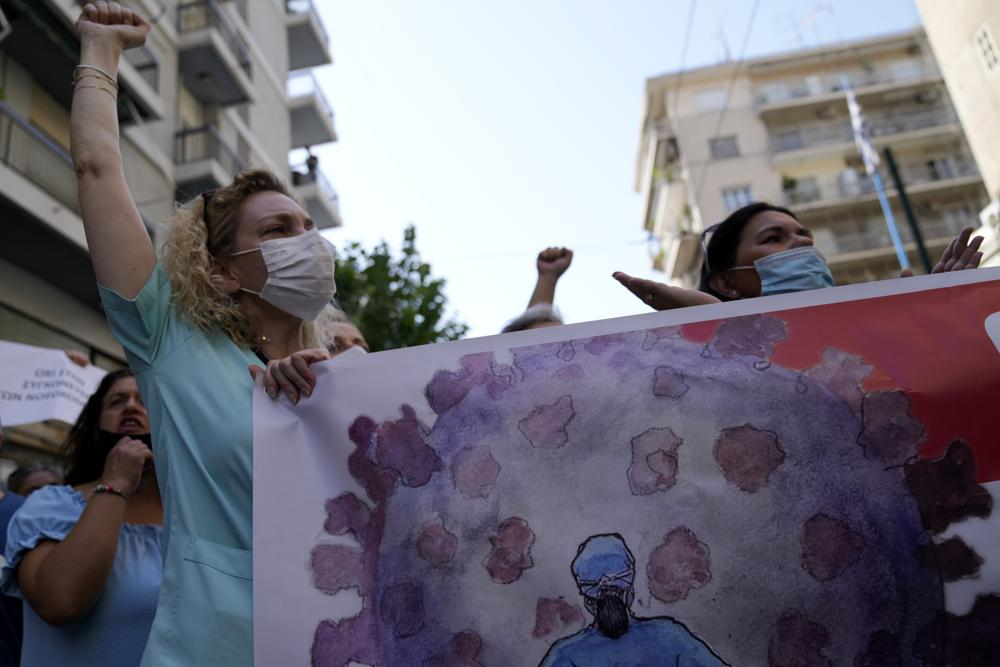 Health workers take part in a rally in Athens, Greece. (AP Photo/Thanassis Stavrakis)