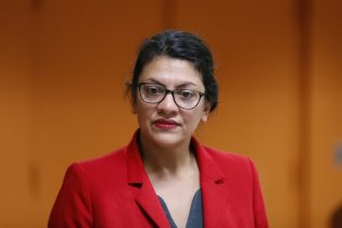 U.S. Rep. Rashida Tlaib, (D-Mich.) listens to a question from a constituent in Wixom, Mich. (AP Photo/Paul Sancya)