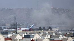 Smoke rises from a deadly explosion outside the airport in Kabul, Afghanistan. (AP Photo/Wali Sabawoon)
