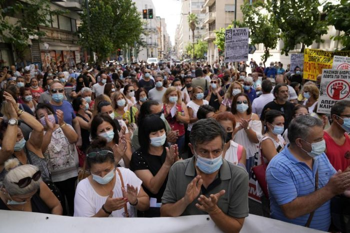 Health workers take part in a rally in Athens. (AP Photo/Thanassis Stavrakis)
