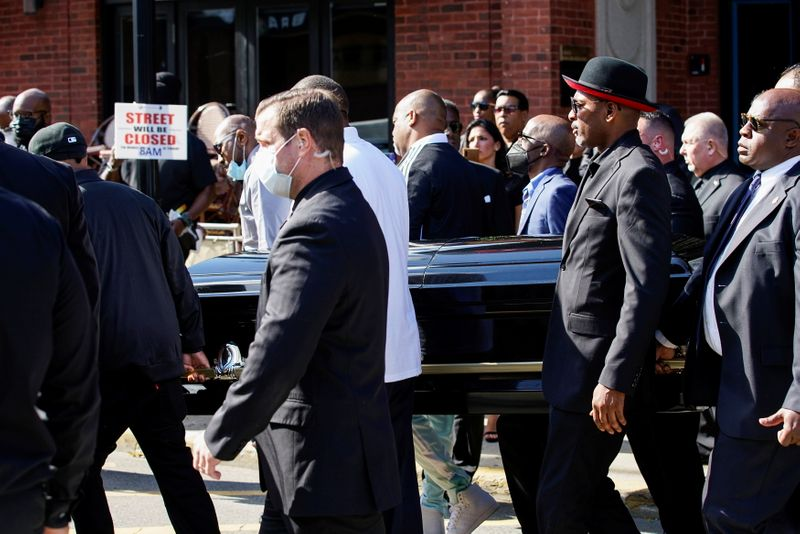Attendees carry the casket of late rapper Marcel Theo Hall, known by his stage name Biz Markie, at the end of his funeral service in Patchogue, New York