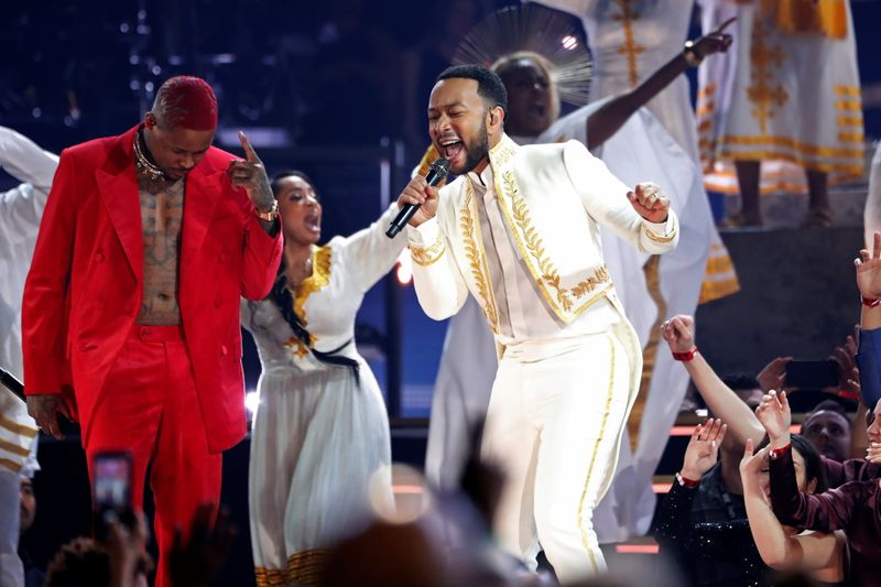FILE PHOTO: YG performs with John Legend at the 62nd Grammy Awards show in Los Angeles