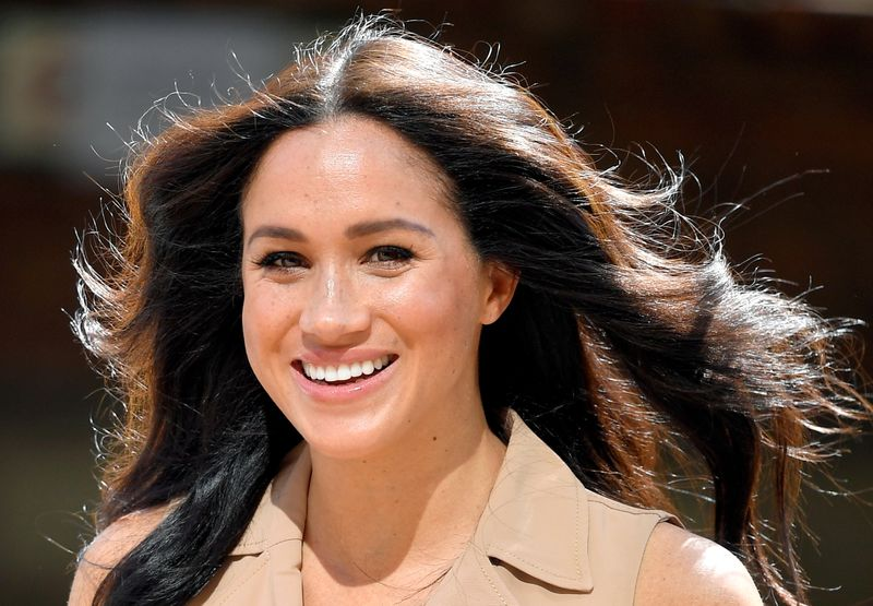 FILE PHOTO: Britain's Meghan Markle, Duchess of Sussex, visits the University of Johannesburg