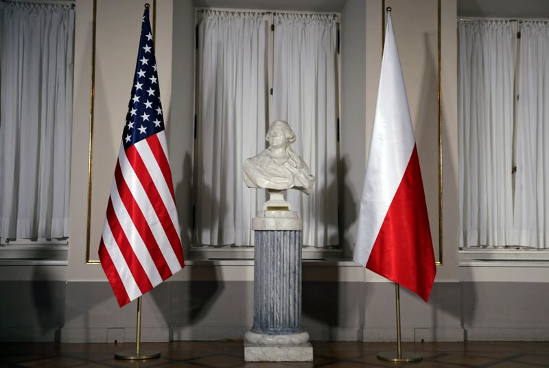 A bust of Polish composer Frederic Chopin is flanked by U.S. and Polish flags ahead of the meeting between U.S. President Trump and Polish President Duda in Warsaw