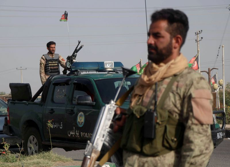 FILE PHOTO: Afghan security forces keep watch at checkpoint in Guzara district of Herat province