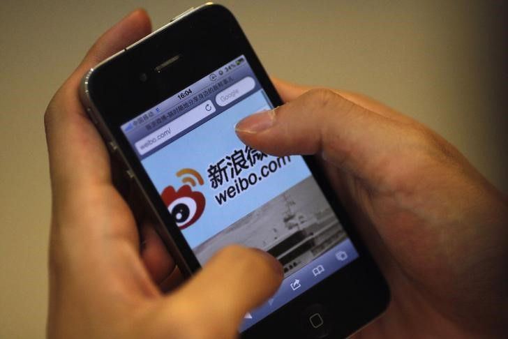 FILE PHOTO: A man visits Sina's Weibo microblogging site in Shanghai