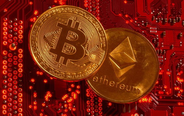 FILE PHOTO: Representations of cryptocurrencies Bitcoin and Ethereum are placed on PC motherboard in this illustration taken