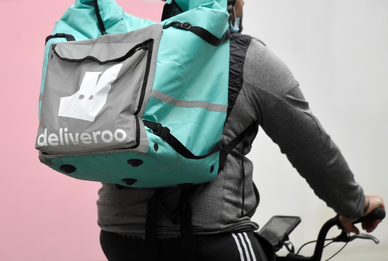 FILE PHOTO: A Deliveroo delivery rider cycles in London