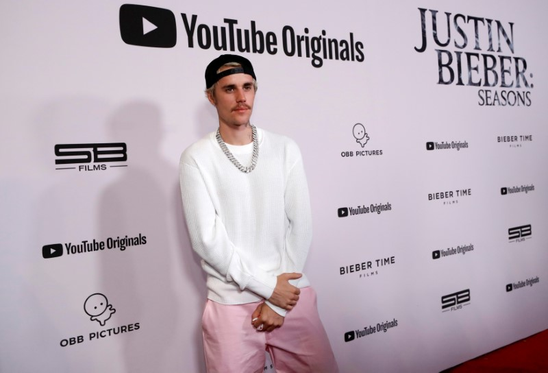 Singer Bieber poses at the premiere for the documentary television series