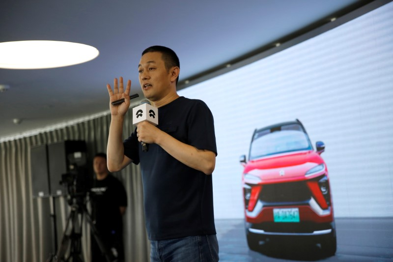 William Li, founder and chief executive officer (CEO) of the electric vehicle maker NIO Inc, speaks at a launch event on battery leasing service in Beijing
