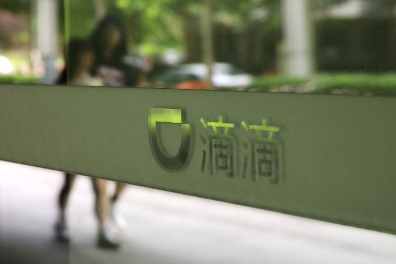 FILE PHOTO: FILE PHOTO: Sign of Chinese ride-hailing service Didi is seen at its headquarters in Beijing