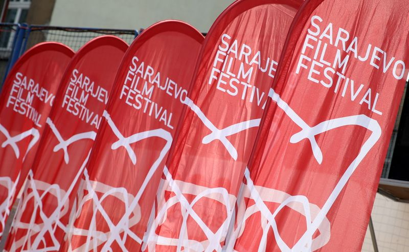 Sarajevo Film Festival logo is seen on the flags at the Open Air Cinema in Sarajevo