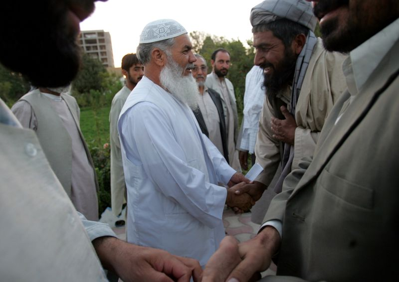 FILE PHOTO: Former governor Ismail Khan greets visitors in Herat.