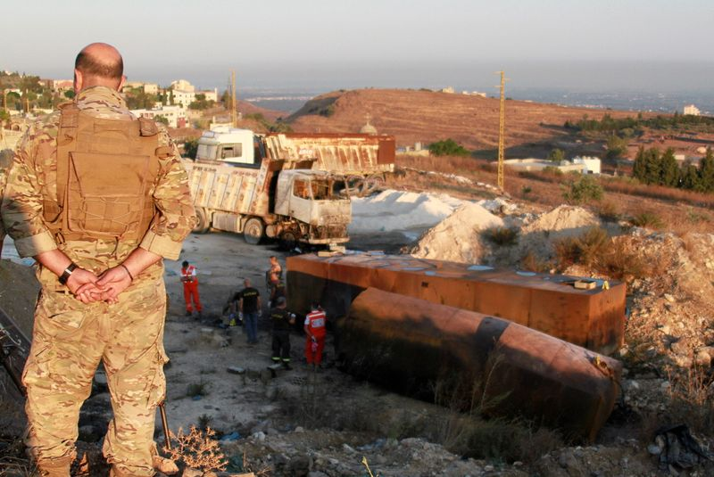 FILE PHOTO: A Lebanese army soldier stands guard near the site of a fuel tank explosion in Akkar