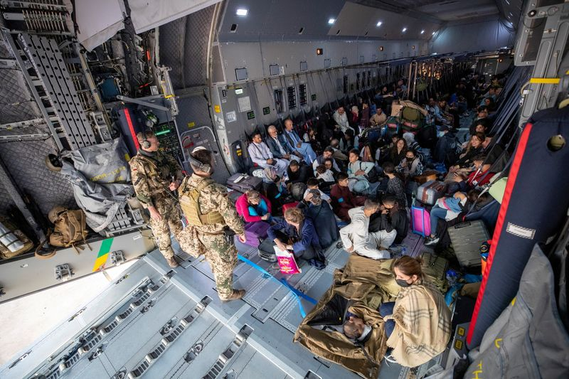 Evacuees from Afghanistan arrive in an Airbus A400 transport aircraft of the German Air Force Luftwaffe in Tashkent