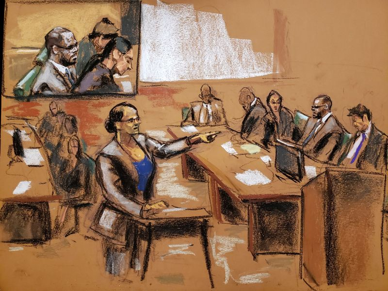 Assistant U.S. Attorney Maria Cruz Melendez points at R Kelly at Brooklyn's Federal District Court