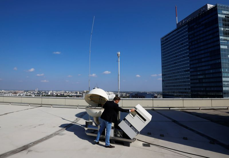 FILE PHOTO: A radionuclide project manager checks a CTBTO radionuclide particulate station in Vienna